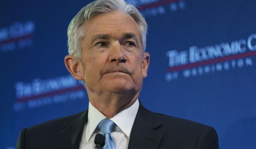 FILE- In this Jan. 10, 2019, file photo Federal Reserve Board Chair Jerome Powell pauses as he talks with Carlyle Group co-CEO David Rubenstein during the Economic Club of Washington luncheon, in Washington. On Wednesday, Jan. 30, the Federal Reserve releases its latest monetary policy statement after a two-day meeting. (AP Photo/Carolyn Kaster, File)
