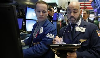 Specialist Stephen Naughton, left, and trader Fred DeMarco work on the floor of the New York Stock Exchange, Tuesday, Jan. 29, 2019. Stocks are opening slightly higher on Wall Street as several big U.S. companies reported solid results for the latest quarter. (AP Photo/Richard Drew)