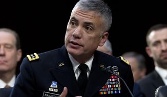 National Security Agency Director Gen. Paul Nakasone testifies before the Senate Intelligence Committee on Capitol Hill in Washington Tuesday, Jan. 29, 2019. (AP Photo/Jose Luis Magana)