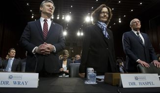 From left, FBI Director Christopher Wray, CIA Director Gina Haspel and Director of National Intelligence Daniel Coats arrive to testify before the Senate Intelligence Committee on Capitol Hill in Washington Tuesday, Jan. 29, 2019. (AP Photo/Jose Luis Magana)