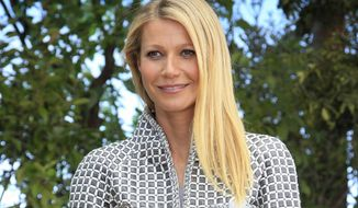 FILE - In this Jan. 26, 2016, file photo, Gwyneth Paltrow poses for photographers before Chanel's Spring-Summer 2016 Haute Couture fashion collection in Paris. A Utah man filed a lawsuit Tuesday, Jan. 29, 2019, accusing Paltrow of causing him brain injuries and broken ribs when she crashed into him at the Deer Valley Ski Resort in Park City, Utah in 2016. (AP Photo/Thibault Camus, File)