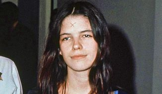 FILE - This March 29, 1971, file photo shows Leslie Van Houten in a Los Angeles lockup. The youngest follower of murderous cult leader Charles Manson will ask a state panel to recommend her for parole. Van Houten, who is now 69, is scheduled for a parole hearing Wednesday, Jan. 30, 2019 at the California Institute for Women. Van Houten was previously recommended for parole twice by a state panel but former California Gov. Jerry Brown blocked her release. (AP Photo, File)