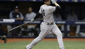 FILE - In this Sept. 26, 2018, file photo, New York Yankees' Neil Walker bats during the team's baseball game against the Tampa Bay Rays in St. Petersburg, Fla. Walker has agreed to a one-year contract with the Miami Marlins and is expected to compete for a starting job. (AP Photo/Chris O'Meara, File)