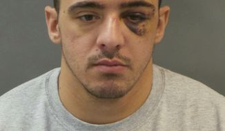 This Jan 28, 2019 booking photo released by St. Louis Police Department shows officer Nathaniel Hendren after he was booked Monday on a charge of involuntary manslaughter. The St. Louis police officer is in custody, three days after he was charged with involuntary manslaughter in the death of a female colleague. Hendren was charged Friday and booked Monday. Prosecutors say Hendren and Katlyn Alix were taking turns Thursday pulling the trigger of a gun while pointing it at each other when it went off. (St. Louis Police Department via AP)