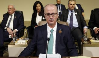 FILE - In this Sunday, Jan. 20, 2019 file photo, Palestinian Prime Minister Rami Hamdallah, attends the Arab Economic and Social Development Summit, in Beirut, Lebanon. On Tuesday, Jan. 29, 2019, Hamdallah offered the resignation of his government to Palestinian President Mahmoud Abbas, in a new step toward ending a failed attempt at reconciling with the rival Hamas movement. Abbas did not immediately act on the resignation offer submitted Tuesday by Prime Minister Rami Hamdallah. (AP Photo/Bilal Hussein, File)