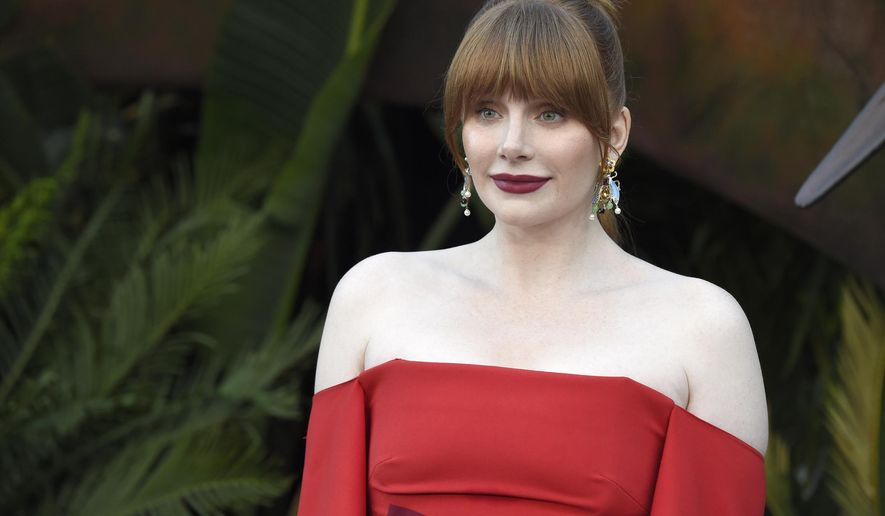 """FILE -- In this Tuesday, June 12, 2018 file photo actor Bryce Dallas Howard arrives at the Los Angeles premiere of """"Jurassic World: Fallen Kingdom"""" at the Walt Disney Concert Hall. Howard, an actor, producer and director, has been named 2019 Woman of the Year by Harvard University's Hasty Pudding Theatricals student group. (Photo by Chris Pizzello/Invision/AP, File)"""