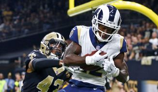 FILE - In this Nov. 4, 2018, file photo, Los Angeles Rams wide receiver Brandin Cooks (12) pulls in a touchdown reception in front of New Orleans Saints free safety Marcus Williams (43) in the first half of an NFL football game in New Orleans. Cooks is the first player in NFL history to have three consecutive 1,000-yard receiving seasons with three different teams. (AP Photo/Butch Dill, File) **FILE**