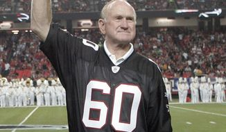 "FILE - In this Sept. 20, 2009, file photo, former Atlanta Falcons Pro Bowler Tommy Nobis is introduced along with other members of the 1966 inaugural team during halftime of an NFL football game against the Carolina Panthers in Atlanta. Nobis, a hard-hitting linebacker for Atlanta and the University of Texas who earned the nickname ""Mr. Falcon,"" had the most severe form of chronic traumatic encephalopathy. And now, as Atlanta prepares to host the Super Bowl, the descent of the NFL upon their hometown is a reminder for his family of the impact, both good and bad, that football has had on them.  (AP Photo/John Amis, File)"