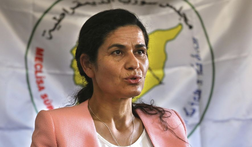 FILE - In this July 25, 2017 file photo, Ilham Ahmed, the co-president of the Syrian Democratic Council, the political wing of the Kurdish-led forces backed by the US in Raqqa, gives an interview to The Associated Press, in Kobani, north Syria. Ahmed, in Washington on Tuesday, Jan. 29, 2019, said the United States is seeking to broker an agreement between her group and Turkey over how to manage northeastern Syria once American troops withdraw. Ahmed was in Washington to lobby for a negotiated U.S. troop withdrawal that would secure her forces' continued presence. (AP Photo/Hussein Malla, File)