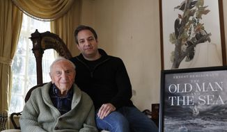 "Ernest Hemingway's close friend and biographer A.E. Hotchner, left, poses for a photograph with his son Tim Hotchner, Tuesday, Jan. 22, 2019, in the Hotchner family home in Westport, Conn. When the 1958 film adaptation ""The Old Man and the Sea"" hit theaters, Ernest Hemingway told his close friend, the senior Hotchner, that he hated it and urged his writer pal to do his own adaptation someday. Now 101, and with Tim's help, Hotchner has finally completed Hemingway's request. Their stage adaptation of ""The Old Man and the Sea"" is set to premiere in Pittsburgh on Feb. 1. (AP Photo/Kathy Willens)"