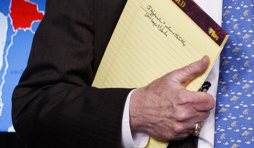 National security adviser John Bolton holds his notes during a press briefing at the White House, Monday, Jan. 28, 2019, in Washington. (AP Photo/ Evan Vucci)