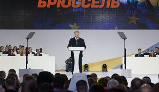Ukrainian President Petro Poroshenko speaks at a meeting with supporters in Kiev, Ukraine, Tuesday, Jan. 29, 2019. Poroshenko declared his intention to run for re-election in March's presidential vote. (AP Photo/Efrem Lukatsky)