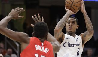 Cleveland Cavaliers' Jordan Clarkson (8) shoots over Washington Wizards' Thomas Bryant (13) during the first half of an NBA basketball game Tuesday, Jan. 29, 2019, in Cleveland. (AP Photo/Tony Dejak)