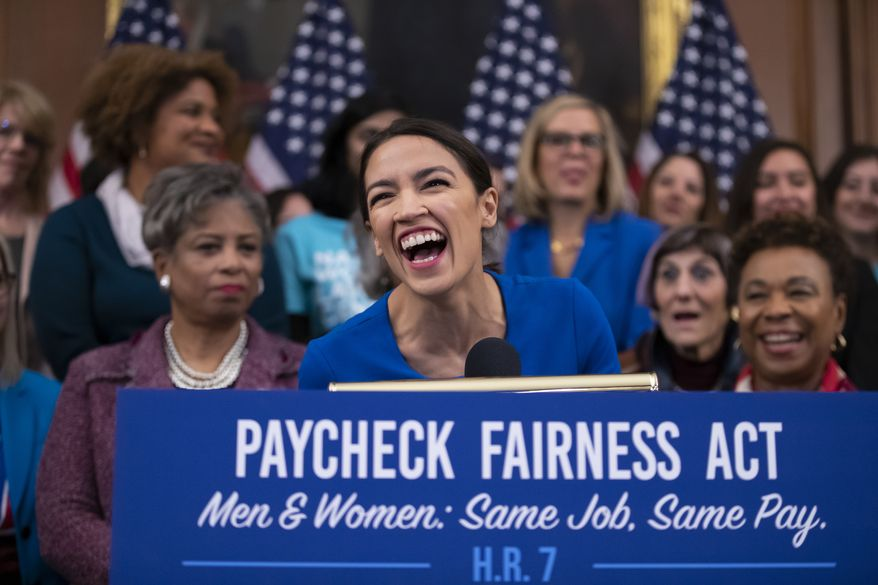 Rep. Alexandria Ocasio-Cortez, D-N.Y., smiles as she speaks at an event to advocate for the Paycheck Fairness Act on the 10th anniversary of President Barack Obama signing the Lilly Ledbetter Fair Pay Act, at the Capitol in Washington, Wednesday, Jan. 30, 2019. (AP Photo/J. Scott Applewhite) ** FILE **