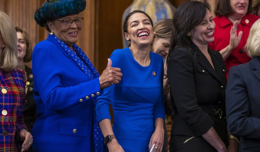 Rep. Alma Adams D-N.C., left, with Rep. Alexandria Ocasio-Cortez, D-N.Y., smiles during an event to advocate for the Paycheck Fairness Act on the 10th anniversary of President Barack Obama signing the Lilly Ledbetter Fair Pay Act, at the Capitol in Washington, Wednesday, Jan. 30, 2019. The legislation, a top tier issue for the new Democratic majority in the House, would strengthen the Equal Pay Act of 1963 and guarantee that women can challenge pay discrimination and hold employers accountable.(AP Photo/J. Scott Applewhite)