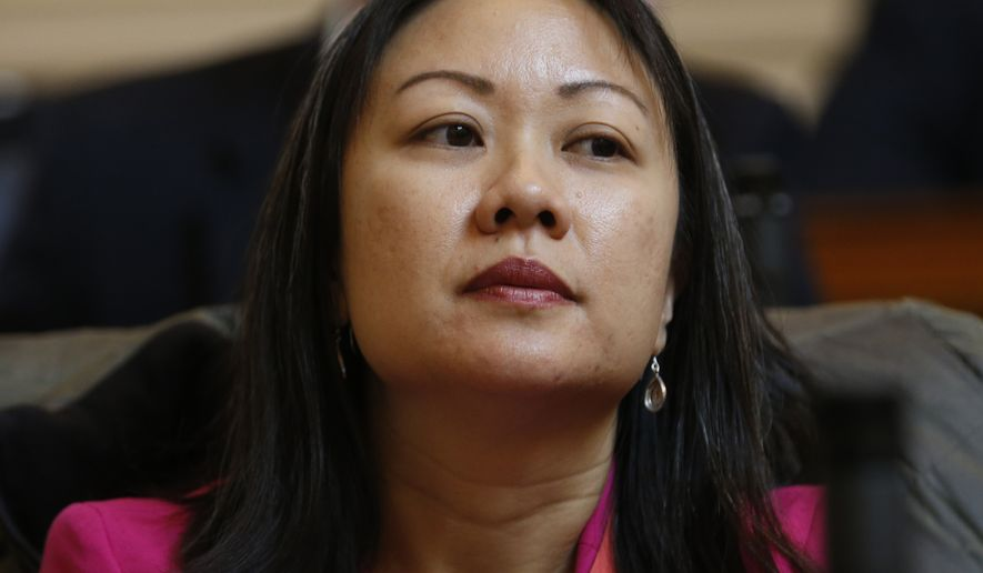Del. Kathy Tran, D-Fairfax, listens to a speech on the floor of the House during session at the Capitol in Richmond, Va., Wednesday, Jan. 30, 2019. Tran's abortion bill is erupting into a fierce partisan clash as video of a legislative hearing goes viral. (AP Photo/Steve Helber)