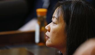Del. Kathy Tran, D-Fairfax, applauds a speech on the floor of the House during session at the Capitol in Richmond, Va., Wednesday, Jan. 30, 2019. Tran's abortion bill is erupting into a fierce partisan clash as video of a legislative hearing goes viral. (AP Photo/Steve Helber)