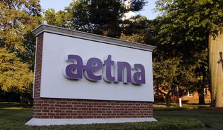 FILE - In this June 1, 2017 file photo,. a sign stands on the campus of the Aetna headquarters in Hartford, Conn. Aetna will pay $935,000 after one of its vendors sent letters to California patients that revealed via a window on the envelopes that the recipients were taking HIV-related medications. California Attorney General Xavier Becerra said Wednesday, Jan. 30, 2019, that the settlement resolves allegations that Aetna violated state health privacy laws. (AP Photo/Bill Sikes, File)