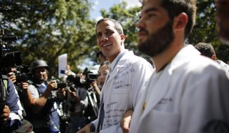 Opposition National Assembly President Juan Guaido takes part in a walkout against President Nicolas Maduro, in Caracas, Venezuela, Wednesday, Jan. 30, 2019. The 35-year-lawmaker has transformed from a little-known opposition figure into a commanding force in the nation's politics with the backing of U.S. President Donald Trump and two dozen other nations recognizing him as Venezuela's interim president. (AP Photo/Ariana Cubillos)