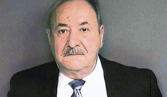 This booking photograph released Wednesday, Jan. 30, 2019, by the Connecticut State's Attorney Office shows John Mallozzi, a former Democratic Party official from Stamford, Conn., charged with orchestrating the filing of at least 26 forged ballots in the 2015 municipal elections.  (Connecticut State's Attorney Office via AP)