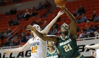Oklahoma State forward Vivian Gray (12) and Baylor center Kalani Brown (21) reach for a rebound in the first half of an NCAA college basketball game in Stillwater, Okla., Wednesday, Jan. 30, 2019. (AP Photo/Sue Ogrocki)