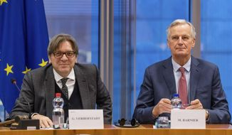 European Parliament Brexit coordinator Guy Verhofstadt, left, and European Union chief Brexit negotiator Michel Barnier talk at the start of a Brexit Steering Group meeting at the European Parliament in Brussels on Wednesday Jan. 30, 2019. British Prime Minister Theresa May on Tuesday won a few weeks to salvage a Brexit deal but headed toward a clash with the European Union by promising to overhaul the divorce agreement she spent a year and a half negotiating with the bloc. (AP Photo/Geert Vanden Wijngaert)