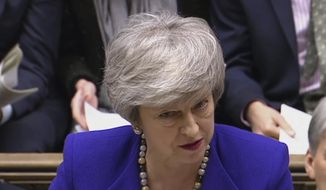 In this grab taken from video, Britain's Prime Minister Theresa May speaks during Prime Minister's Questions in the House of Commons, London, Wednesday, Jan. 30, 2019. (PA via AP) ** FILE **