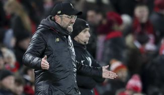 Liverpool manager Jurgen Klopp gestures during the English Premier League soccer match between Liverpool and Leicester City, at Anfield Stadium, Liverpool, England, Wednesday, Jan.29, 2019. (AP Photo/Jon Super)