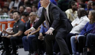 Chicago Bulls head coach Jim Boylen watches during the first half of an NBA basketball game against the Miami Heat, Wednesday, Jan. 30, 2019, in Miami. (AP Photo/Lynne Sladky)