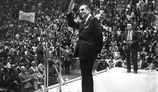 "FILE - In this undated file photo, Chilean President Eduardo Frei Montalva, who governed Chile from 1964 to 1970, waves to supporters, in Santiago, Chile. A Chilean judge ruled Wednesday, Jan. 30, 2019 that Frei Montalva was poisoned to death with ""toxic substances"" that were gradually introduced into his body in 1982. Six people were sentenced to between three and 10 years in prison. (La Tercera via AP, File )"