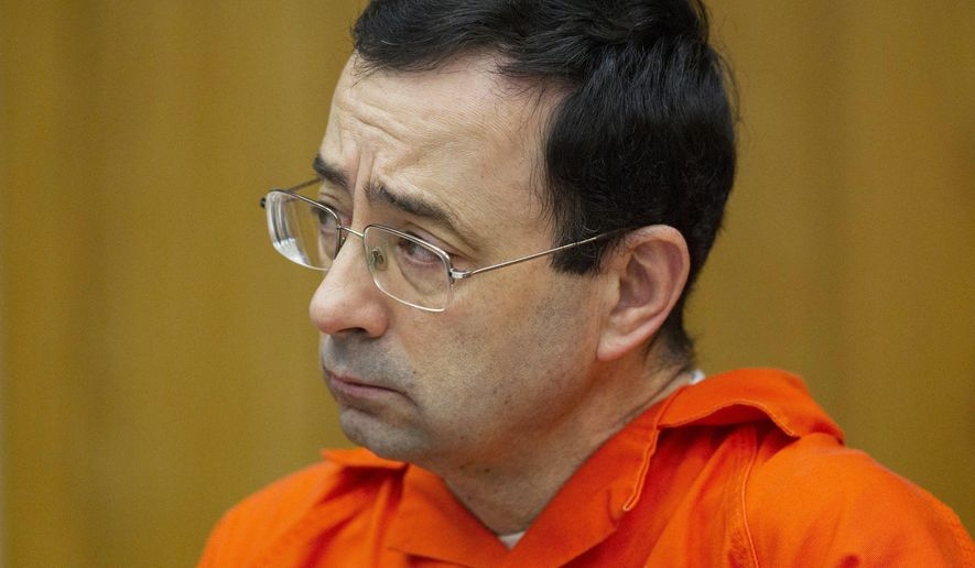 In this Jan. 31, 2018, file photo, Larry Nassar appears for his sentencing at Eaton County Circuit Court in Charlotte, Mich. (Cory Morse/The Grand Rapids Press via AP, File)