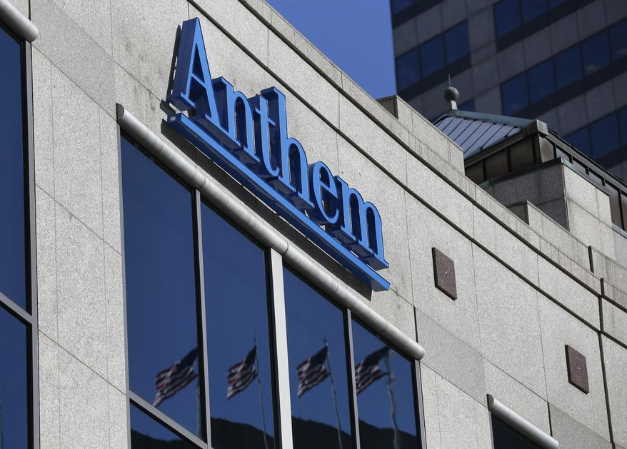 FILE - In this Feb. 5, 2015, file photo, the Anthem logo hangs at the health insurer's corporate headquarters in Indianapolis. Anthem Inc., reports earnings Wednesday, Jan. 30, 2019. (AP Photo/Michael Conroy, File)