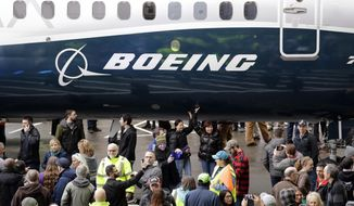FILE- In this Feb. 5, 2018, file photo a Boeing 737 MAX 7, the newest version of Boeing's fastest-selling airplane, is displayed during a debut for employees and media of the new jet in Renton, Wash. The Boeing Company reports earnings Wednesday, Jan. 30, 2019. (AP Photo/Elaine Thompson, File)