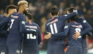 PSG's squad celebrates the opening goal during the French Cup soccer match between Paris Saint Germain and Strasbourg at the Parc des Princes stadium in Paris, Wednesday, Jan. 23, 2019. (AP Photo/Michel Euler)