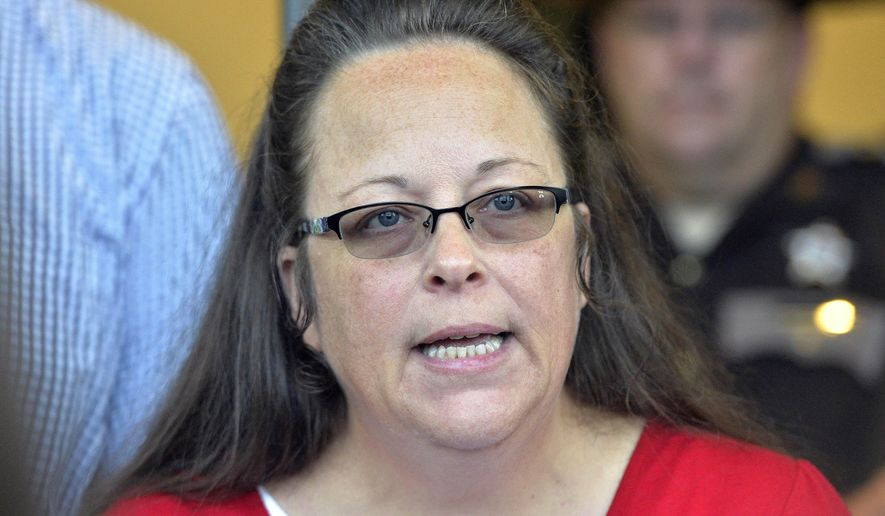 In this Sept. 14, 2015, file photo, Rowan County Clerk Kim Davis makes a statement to the media at the front door of the Rowan County Judicial Center in Morehead, Ky. Outside attorneys for Republican Kentucky Gov. Matt Bevin say the former county clerk who stopped issuing marriage licenses because of her opposition to gay marriage broke the law and the state shouldn't have to pay legal fees for people who sued her. A federal appeals court is scheduled to hear arguments Thursday, Jan. 31, 2019, about who should pay the lawyers for several gay and straight couples who sued Davis in 2015.  (AP Photo/Timothy D. Easley, File)