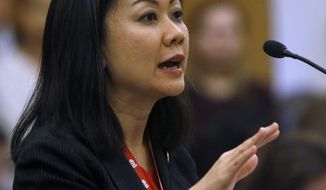In this Monday, Jan. 28, 2019 photo, Del. Kathy Tran, D-Fairfax, presents HB2491, her bill dealing with eliminating some requirements for abortion, to a subcommittee of the House Courts of Justice committee inside the State Capitol in Richmond, Va. The bill was killed after an intense questioning of Tran by House Majority Leader C. Todd Gilbert, R-Shenandoah, the subcommittee chairman. (Bob Brown/Richmond Times-Dispatch via AP)