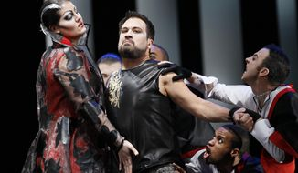 File-In this Feb. 24, 2012 file  photo, David Daniels, second from left, performs as Rinaldo, during the final dress rehearsal at the Lyric Opera of Chicago's production of Rinaldo. Police have arrested Daniels, a renowned opera singer and University of Michigan professor, on allegations that he and his husband in 2010 sexually assaulted a singer in Houston. (AP Photo/Charles Rex Arbogast, File)