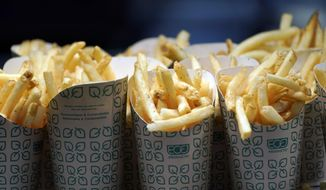 French fries wait to be served during a tour of Mercedes-Benz Stadium for the NFL Super Bowl 53 football game Tuesday, Jan. 29, 2019, in Atlanta. (AP Photo/David J. Phillip) ** FILE **
