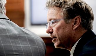 U.S. Sen. Rand Paul, R-Ky., talks with his attorney Tom Kerrick Tuesday, Jan. 29, 2019, during the second day of a civil trial involving Paul and his neighbor Rene Boucher in Warren Circuit Court in Bowling Green, Ky. Paul testified that he feared for his life after being hit by a blindside tackle from a neighbor, who broke several of his ribs while he was doing yard work at his Kentucky home. (Bac Totrong/Daily News via AP)