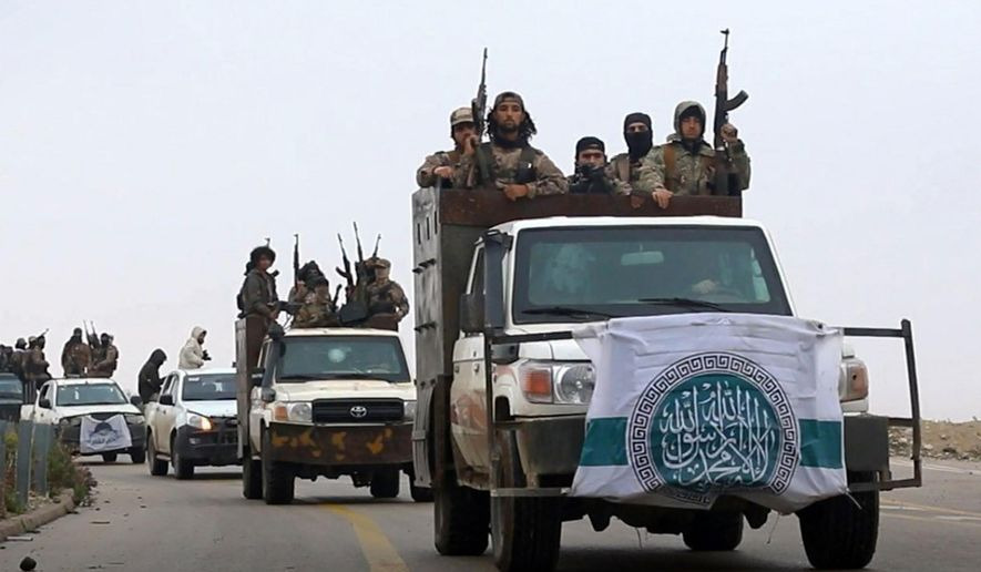 This photo released Dec. 4, 2018, by the al-Qaeda-affiliated Ibaa News Agency, shows al-Qaeda-linked fighters driving their vehicles during a military drill in northern Syria. (Ibaa News Agency, via AP) ** FILE **