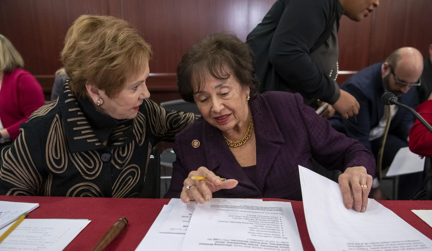 Rep. Kay Granger, R-Texas, left, ranking member of the House Appropriations Committee, speaks with Appropriations Chair Nita Lowey, D-N.Y., as a bipartisan group of House and Senate bargainers finished their first meeting to craft a border security compromise in hope of avoiding another government shutdown, at the Capitol in Washington, Wednesday, Jan. 30, 2019. (AP Photo/J. Scott Applewhite) **FILE**