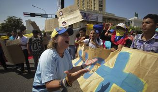 People chant anti-government slogans in a walkout against President Nicolas Maduro, in Maracaibo, Venezuela, Wednesday, Jan. 30, 2019. Venezuelans are exiting their homes and workplaces in a walkout organized by the opposition to demand that Maduro leave power. (AP Photo/Boris Vergara)