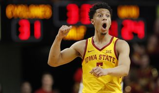 Iowa State guard Lindell Wigginton reacts after making a 3-point basket during the first half of the team's NCAA college basketball game against West Virginia, Wednesday, Jan. 30, 2019, in Ames, Iowa. (AP Photo/Charlie Neibergall)