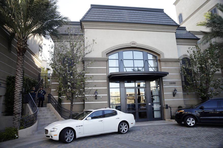 This March 3, 2015, file photo shows an upscale apartment complex where authorities say a birth tourism business charged pregnant women $50,000 for lodging, food and transportation, after it was raided in Irvine, Calif. On Thursday, Jan. 31, 2019, authorities announced they have charged 20 people in an unprecedented crackdown on businesses that helped hundreds of Chinese women travel to the United States to give birth to American citizen children. (AP Photo/Jae C. Hong, File)