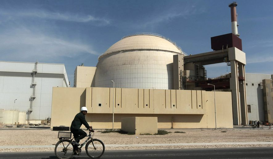 In this Oct. 26, 2010 file photograph, a worker rides a bicycle in front of the reactor building of the Bushehr nuclear power plant, just outside the southern Iranian city of Bushehr.  (AP Photo/Mehr News Agency, Majid Asgaripour, File) **FILE**