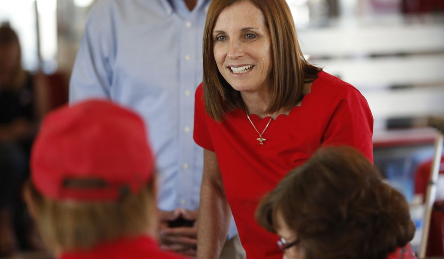 FILE - In this Nov. 6, 2018, file photo, then-Arizona Republican senatorial candidate Martha McSally, speaks with voters, at Chase's diner in Chandler, Ariz. he Federal Election Commission says Arizona Sen. Martha McSally may have accepted $270,000 in campaign contributions that exceeded legal limits. Federal candidates can collect $2,700 from a single donor during a primary election and an additional $2,700 from that same person during the general. But agency flagged dozens of contributions to McSally that appear to exceed those limits. (AP Photo/Matt York, File)