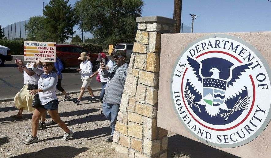 This June 2018 photo shows protesters walking along Montana Avenue outside the El Paso Processing Center, in El Paso, Texas. Federal immigration officials are force feeding some of the immigrants who have been on hunger strike for nearly a month inside the Texas detention facility, The Associated Press has learned. (Rudy Gutierrez/The El Paso Times via AP)
