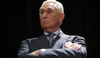 Roger Stone, longtime friend and confidant of President Donald Trump, waits to speak to members of the media at at a hotel in Washington, Thursday, Jan. 31, 2019. (AP Photo/Pablo Martinez Monsivais)
