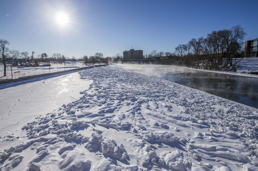 Bitter cold creates icy conditions on the Saint Joseph River, near Howard Park, on Thursday, Jan. 31, 2019, in South Bend, Ind. (Robert Franklin/South Bend Tribune via AP)