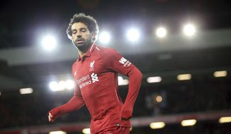 Liverpool forward Mohamed Salah runs during the English Premier League soccer match between Liverpool and Leicester City, at Anfield Stadium, Liverpool, England, Wednesday, Jan.29, 2019. (AP Photo/Jon Super)
